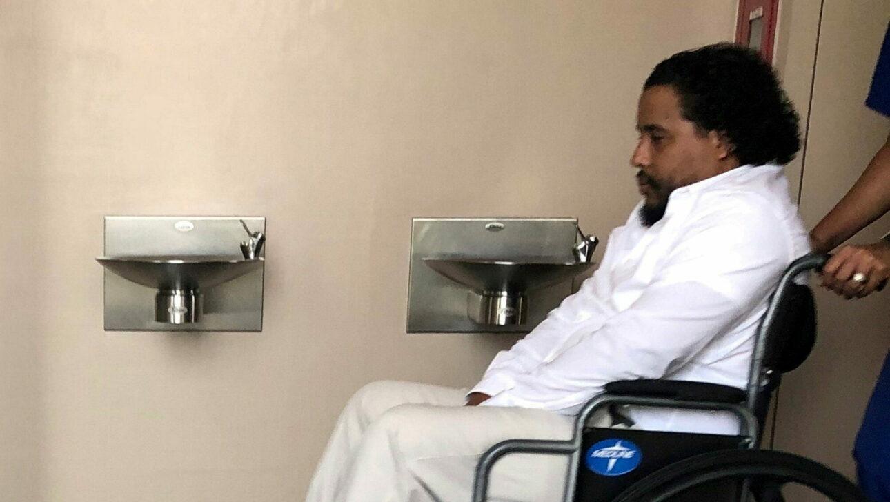 A man in a wheel chair.