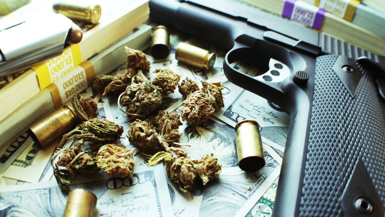 Marijuana with a gun, money, and bullets.