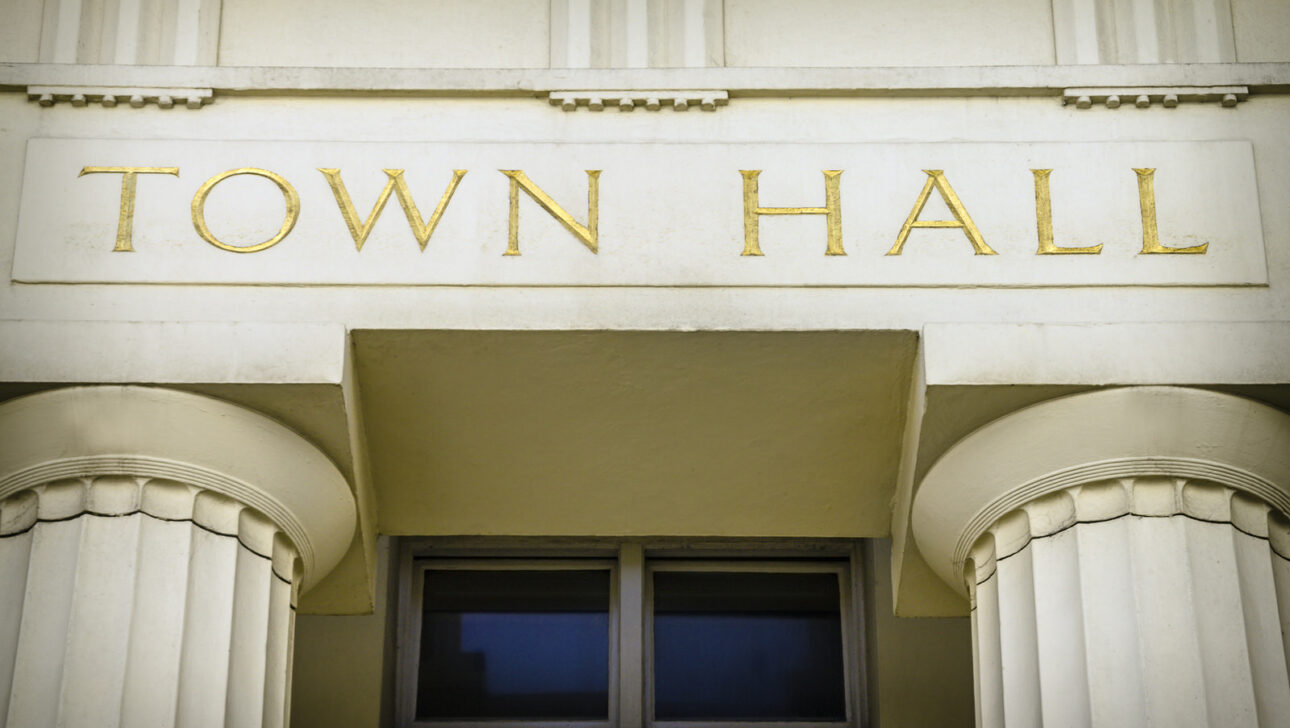 Town Hall signage on the outside of a building.