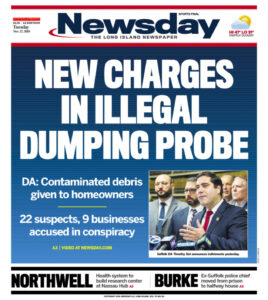 """A newspaper cover that reads, """"New Charges in Illegal Dumping Probe""""."""